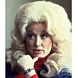 """As Dolly, herself, has said, """"I'm not offended by dumb blonde jokes because I know that I'm not dumb . . . I also know that I'm not blonde."""""""