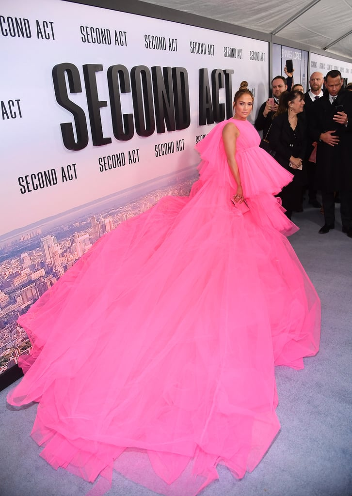 Jennifer freakin' Lopez. The singer flaunts so many breathtaking looks time and time again, it's almost difficult to keep up. She brought the drama to the red carpet for the premiere of her new movie, Second Act, and chose a dramatic hot-pink gown for the occasion.  J Lo's tulle dress is giving us vivid flashbacks to not one but two memorable fashion moments from another pop star: Rihanna. It makes sense, since both Rihanna's and J Lo's gowns were designed by Giambattista Valli. J Lo paired her high-low gown with a Jimmy Choo clutch and heels, plus Lorraine Schwartz jewellery. Check out her outfit from all angles ahead.       Related:                                                                                                           Jennifer Lopez, Queen of Glam, Found the Sparkliest Jumpsuit For You to Wear on NYE