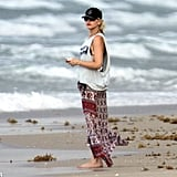 Gwen Stefani layered her leopard-print bikini with a printed skirt and tank top while in Palm Beach, FL, in August 2012.