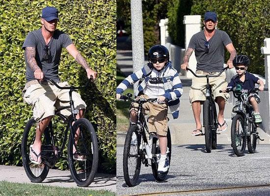 David Beckham Rides A Bike With Romeo Beckham and Brooklyn Beckham