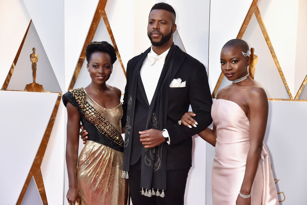 "The Cast of Black Panther Step Away From Wakanda to Grace the Oscars With Their Presence The cast of Black Panther stepped away from Wakanda for one night to grace the Oscars with their appearance on Sunday. While Chadwick Boseman, aka the Black Panther himself, got fans hype by shouting out ""Wakanda forever!"" on the red carpet, Lupita Nyong'o, Danai Gurira, and Winston Duke legit took our breath away as they posed together for the cameras. Lupita even shared a sweet embrace with Daniel Kaluuya, who is nominated for best actor for Get Out. See more of their incredible appearance below."