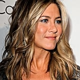 Jennifer Aniston kept her hair flowing and curly in LA for an Elle event.