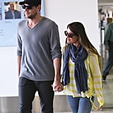 Lea Michele wore a yellow sweater with a purple scarf at LAX with boyfriend Cory Monteith.