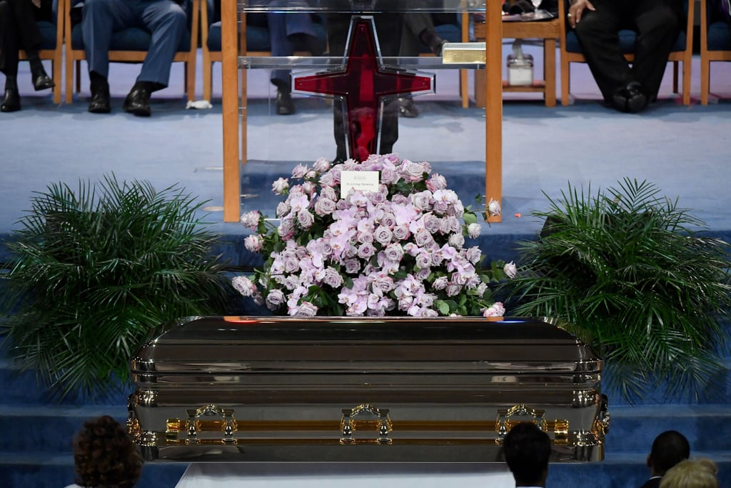 "On Aug. 31, Aretha Franklin's ""Celebration of Life"" began with prayers and songs, filling the streets of her hometown Detroit with music as she was laid to rest. The Queen of Soul passed away on Aug. 16, at the age of 76, after a long battle with pancreatic cancer. The singer's family and friends congregated at Detroit's Greater Grace Temple while massive crowds of fans lined up outside, hoping to pay their respects. Among the funeral-goers are Aretha's fellow musicians, famous actors, religious leaders and a former US President. Aretha's gold casket arrived in a 1940 Cadillac LaSalle hearse while dozens of pink Cadillacs lined up outside the church in honour of her 1985 single ""Freeway of Love."" The pink Cadillacs were in reference to the verse ""We goin' ridin' on the freeway of love in my pink Cadillac,"" a prime example of how her music and influence transcends time.  The hours-long funeral service includes musical tributes from artists such as Stevie Wonder, Chaka Khan, Ariana Grande, and Faith Hill, as well as remarks from the Rev. Jesse Jackson, Smokey Robinson, and former president Bill Clinton. Though the funeral is invite-only, the service will be broadcast on television and streamed online to provide fans a final opportunity to say goodbye. Earlier in the week, fans were able to pay their respects at the Charles H. Wright Museum of African American History for a public viewing for the late Queen of Soul. There will also be an exhibit at the Charles H. Wright Museum entitled ""Think,"" which is described as a tribute to Aretha. Ahead, see photos of the many people who gathered to celebrate and honour the icon's life."