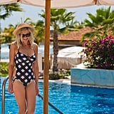 Kirsten Dunst at the pool in a swimsuit.