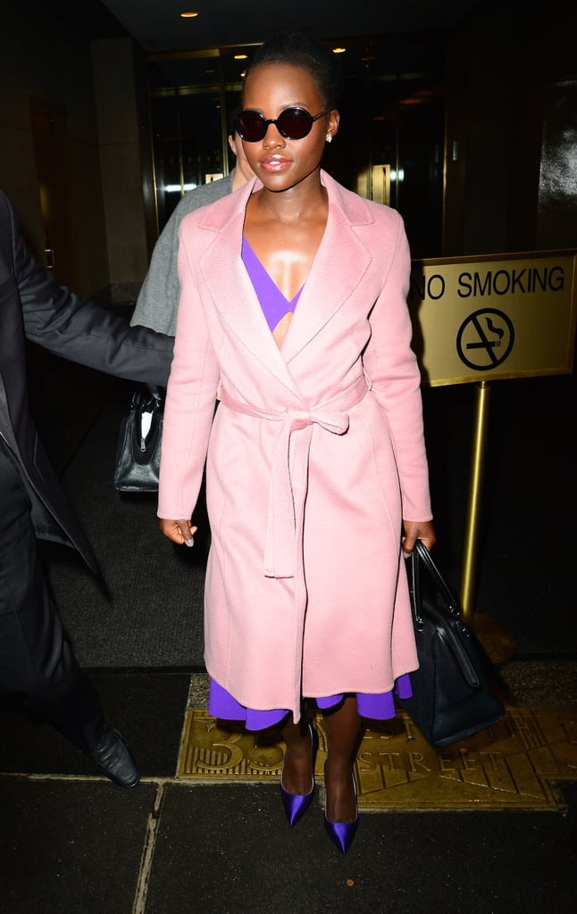 Lupita Nyong'o was spotted leaving the Today show on Wednesday, looking like a real-life Barbie doll. The actress, who recently weighed in on the #OscarsSoWhite controversy, turned heads in a pink trench coat and purple dress while making her way through the streets of NYC, once again proving that she's a perfect human being. Ever since the release of Star Wars: The Force Awakens, Lupita has been killing it on the red carpet. In December, she popped up at not one, but two events, slaying equally at both of them, and last month, she took a break from the spotlight and escaped to the Dominican Republic for a picturesque holiday. Read on to see more of Lupita's ultra-glam outing, and then find out just who she is.