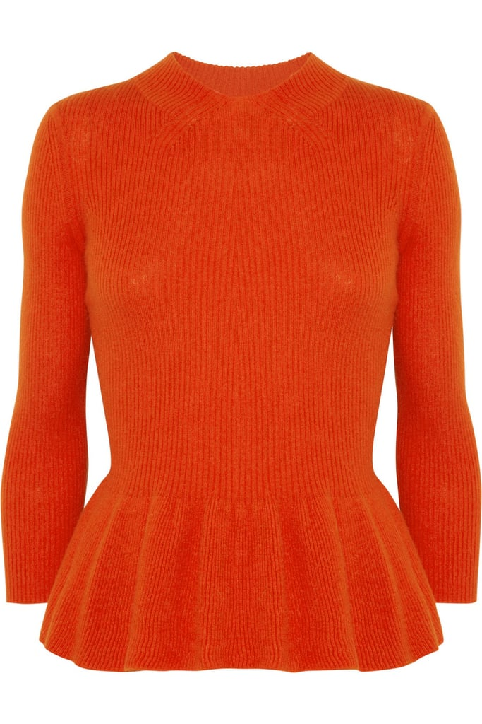 When the temperature drops, reach for this long-sleeved knit sweater instead of your favorite cardigan for a pop of Fall color and style.  Tory Burch Wool-Blend Peplum Sweater ($275)