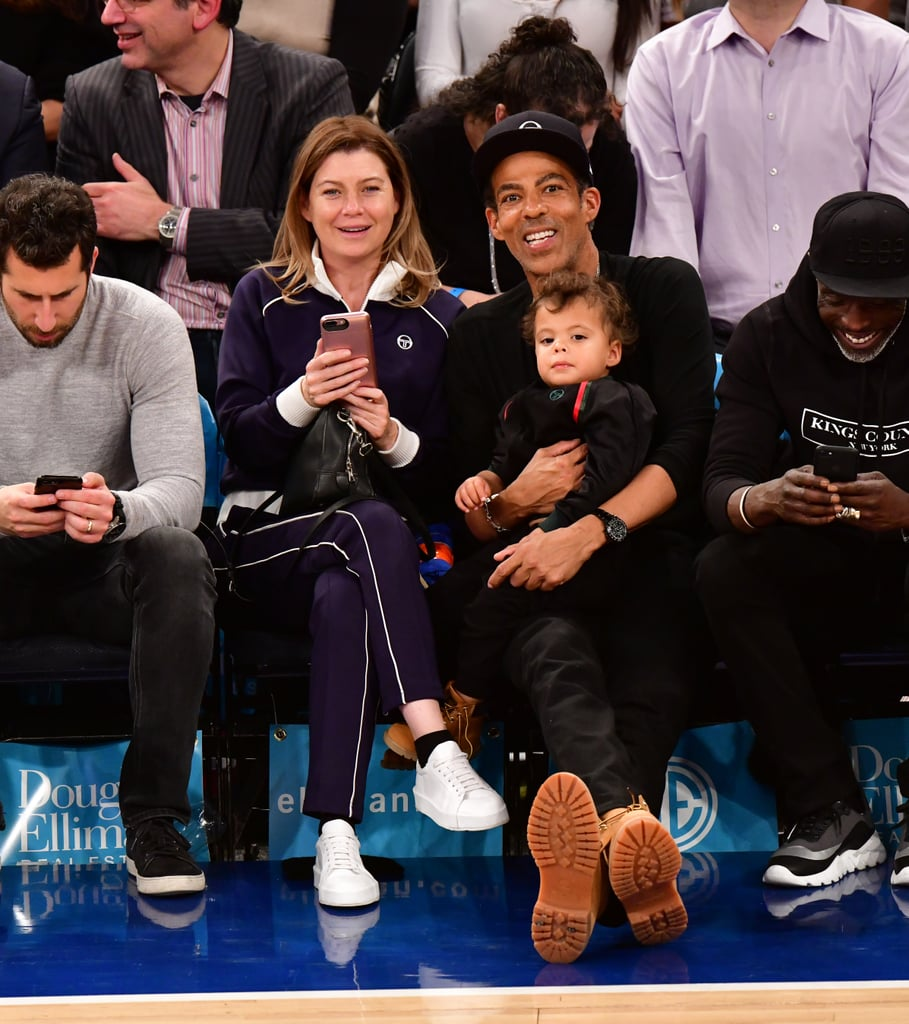 On Tuesday night, the New York Knicks might have taken the lead against the Portland Trailblazers at Madison Square Garden, but the real winners were sitting courtside. Grey's Anatomy star Ellen Pompeo and her husband, Chris Ivery, were in attendance looking all sorts of adorable with their 1-year-old son, Eli Ivery. The three looked cute and casual while watching the game — Ellen sported a navy tracksuit while Chris and Eli matched in all-black outfits and brown boots. As usual, seeing the family made our hearts flutter.  Ellen and Chris, who have been married for 11 years, are also the parents to two other children, Sienna May, 4, and Stella Luna, 9. Ellen has previously opened up about the things that she feels are important to teach her children. As a woman who is such a powerhouse both on screen and off screen, Ellen has said that she also wants her daughters to have their own voices and be forces in their own careers. No doubt all three of Ellen and Chris's children will turn out to be amazing adults, like their parents. Until then, we'll cherish every moment of seeing Ellen and Chris hanging out with their young kiddos. See more sweet photos of the family at the Knicks game ahead.