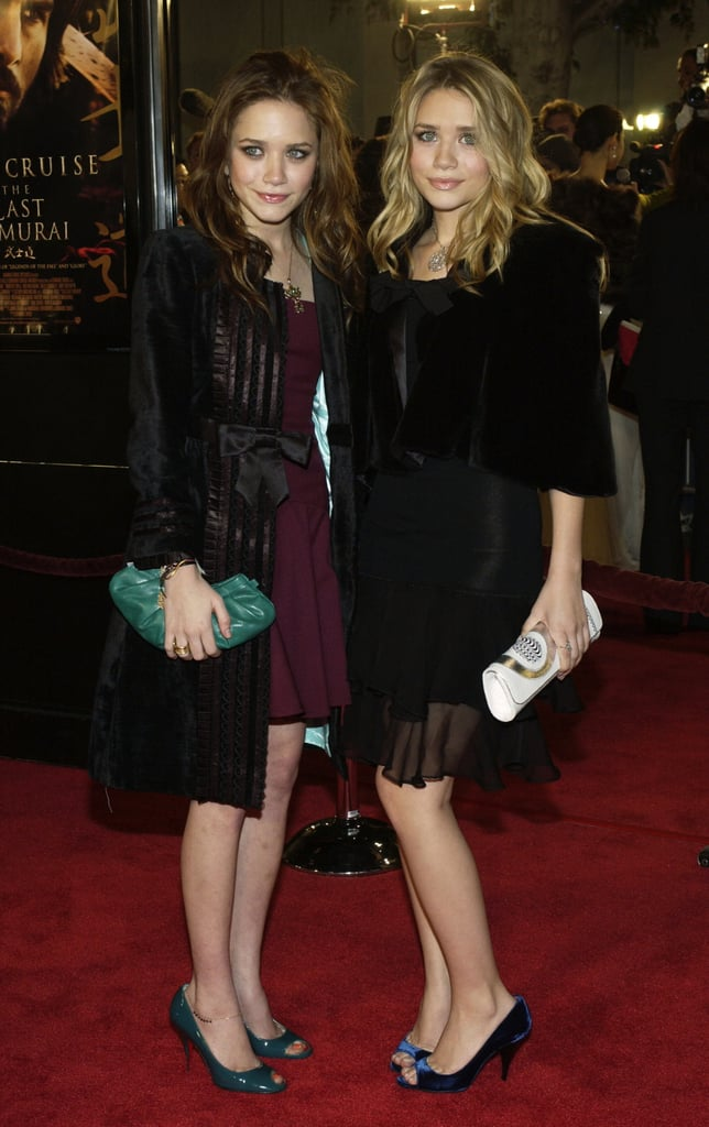 Twinning combo: Ruffle-hemmed minis and blue peep-toe pumps were the ladies' looks of choice for the 2003 premiere of The Last Samurai in Hollywood.  Mary-Kate posed in a deep-purple dress, bow-accented velour coat, patent teal pumps, and a matching clutch. Ashley's navy suede pumps popped against her all-black ensemble.