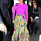 Beyoncé's black topper furthered the vintage-inspired fun of her round sunglasses and vibrant-print skirt.
