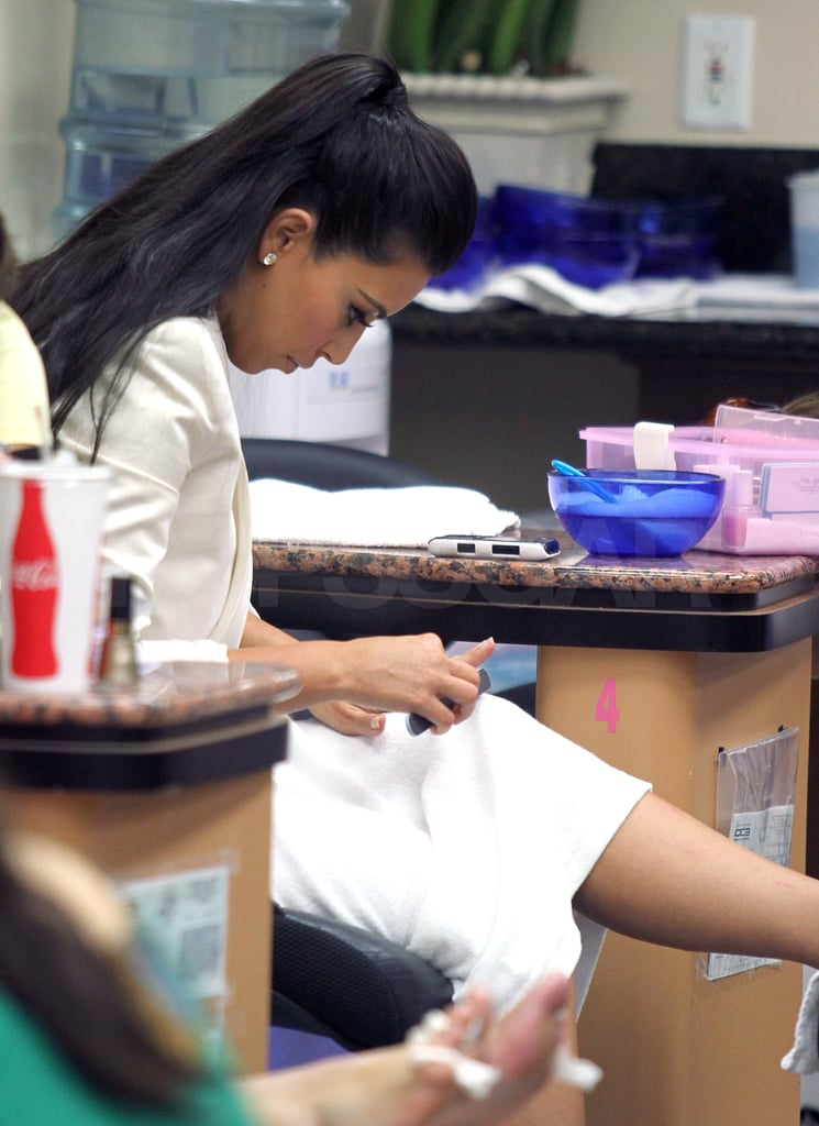 Kim Kardashian inspected her newly painted nails.