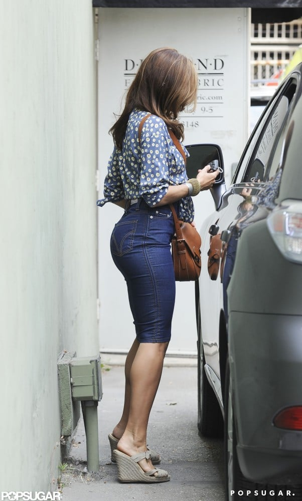 Eva Mendes showed off her curves in a denim skirt while shopping in LA.