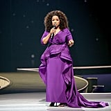 "Oprah wearing a purple Christian Siriano dress on her ""The Life You Want"" tour in September 2014 in Newark, NJ."