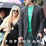 Jessica Simpson laughed as she walked arm in arm with fiancé (and the festively dressed) Eric Johnson in LA in March 2012.