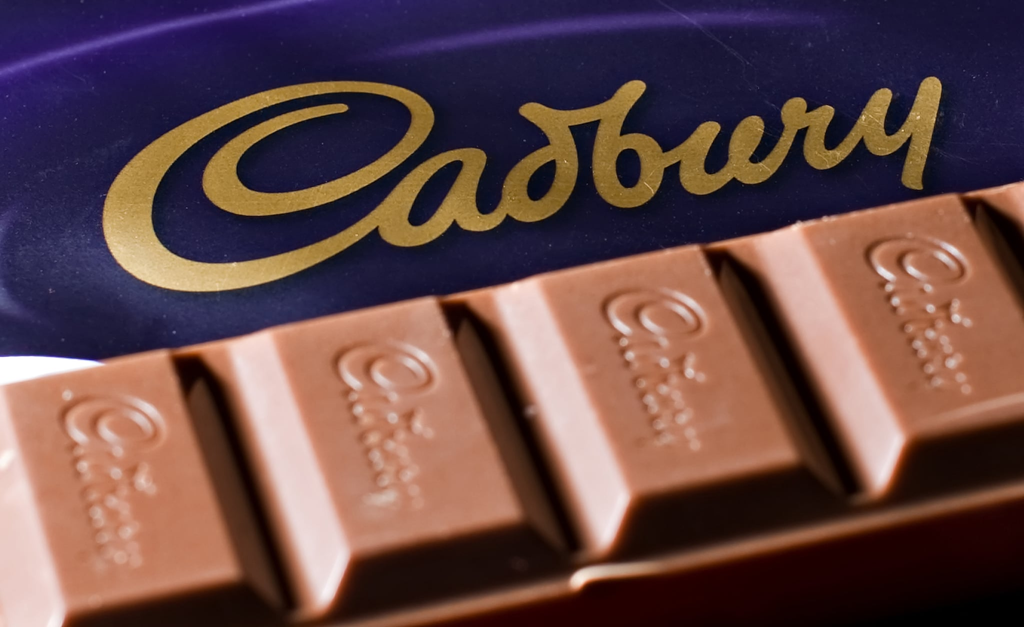 A bar of Cadbury's Dairy Milk chocolate is pictured in London, on January 14, 2010.  US chocolate maker Hershey has authorised a bid to be prepared for British confectioner Cadbury to counter American giant Kraft's 10.5-billion-pound hostile offer, a newspaper reported Thursday. Citing people familiar with the matter, the Financial Times said Hershey had given the go-ahead for a bid to be drawn up and a formal offer could be made by a January 23 deadline. AFP PHOTO/Leon Neal (Photo credit should read LEON NEAL/AFP via Getty Images)