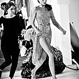 A model rushes to change into her next outfit backstage at Zuhair Murad.