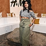 Freida Pinto wearing a crop top and high-waisted trousers at the H&M Loves Coachella tent.