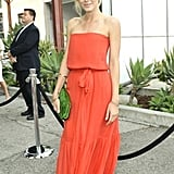 I was swept away by Monet's coral max and green clutch — festive color combo.
