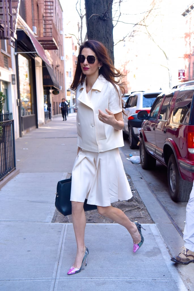 This boxy skirt suit gives us '60s working-girl vibes. Amal looks incredible in white. She keeps this look interesting with a muted pop of color on the heels.
