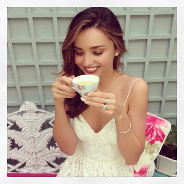 "Miranda Kerr sipped tea from her ""favorite Royal Albert"" teacup in a garden. Source: Instagram user mirandakerr"
