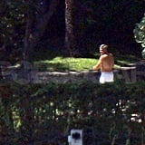 Shirtless George Clooney walked around his Italian estate.