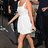 Jaime revealed a bit of leg in a white mini dress with wedge ankle boots.