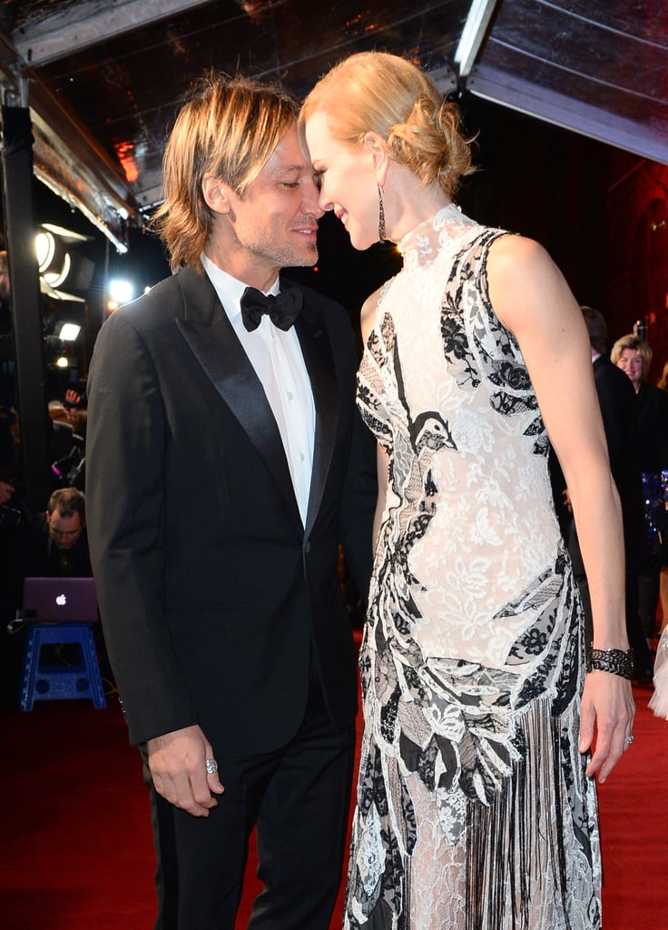 Nicole Kidman had the support of her husband, Keith Urban, at the Evening Standard's theatre awards in London on Sunday. The couple showed their signature sweet PDA on the red carpet while posing for photos together, and Nicole beamed with her new trophy in the press room; during the ceremony, she was honoured with the best actress award for her performance in Photograph 51, in which she played Rosalind Franklin, a scientist who contributed to the discovery of DNA's double helix structure. Nicole had been starring in the play at London's Noel Coward Theatre since September, and Keith was spotted by his wife's side after many of her shows. Keep reading to see Nicole and Keith's latest PDA-filled outing.