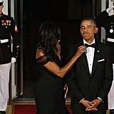 He needs help adjusting his bowtie.