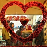 Foreigners browse through gift items at a shop during Valentine's Day in Islamabad, Pakistan.
