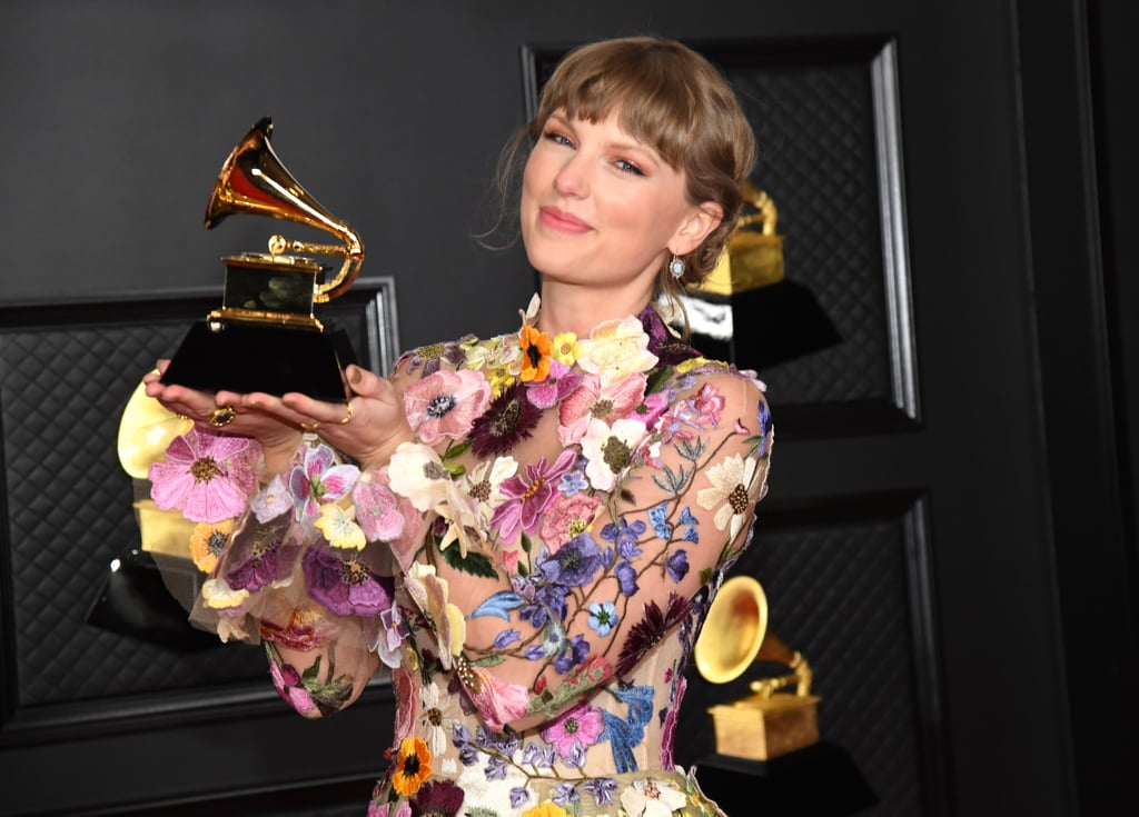 """Can I just talk about how proud of Taylor Swift I am right now? The 31-year-old singer lived her absolute best life at the Grammys. After five years, she made a grand return to the music award show on Sunday night, and I was in complete awe. First, she walked the red carpet in a gorgeous floral dress, then Taylor gave a stunning performance alongside her Folklore collaborators Aaron Dessner and Jack Antonoff. We're talking twinkly lights, a breathtaking set, and an equally masterful medley of """"Cardigan,"""" """"August,"""" and """"Willow."""" It's basically like she took the magic of Folklore and Evermore and brought them to life with her Grammys appearance. Something about seeing her twirl around in her best dress, fearless, is making me EMOTIONAL. She finished off the night by casually making history for her album of the year win. See more of her Grammys appearance ahead.       Related:                                                                                                           Megan Thee Stallion, Taylor Swift, and Everyone Else Who Won at the 2021 Grammy Awards"""