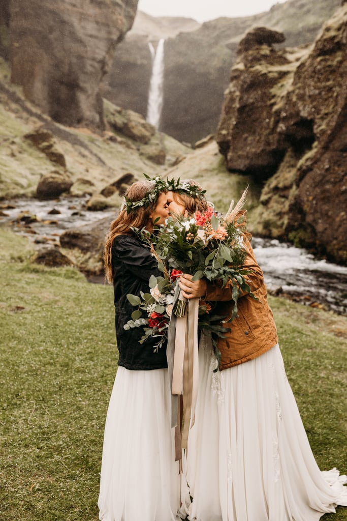 "There's nothing more intimate than a private elopement shared between you and your soulmate, especially in a place as breathtaking as Iceland. Brides Cassidy and Hannah decided to do just that, saying their ""I dos"" in the beautiful Icelandic countryside. Not a soul was in attendance, just themselves, the waterfalls, and their parents, who watched virtually through Facetime. These brides knew what they wanted, and despite the rain, they hiked to their chosen backdrop with filled backpacks, rugged boots, and large coats, all while keeping a tight grip on their bouquets. After their elopement, the newlyweds headed back to Reykjavik to celebrate, sharing a cake to honor their big day. If you're interested in seeing more of this romantic Iceland wedding, have a look through the pictures ahead!      Related:                                                                                                           These Brides Renewed Their Vows in the Most Intimate Setting, and the Photos Are Breathtaking"
