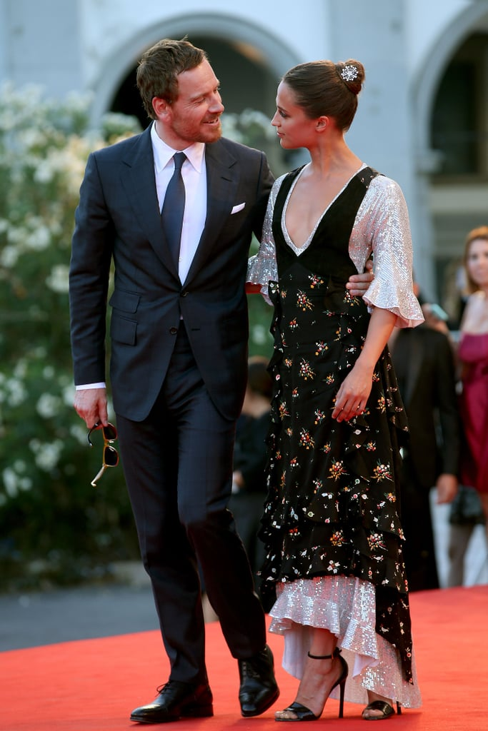 Michael Fassbender and Alicia Vikander are notoriously private about their romance, but that doesn't mean they're any less adorable. Despite staying out of the spotlight for most of their nearly three-year relationship, the pair, who reportedly tied the knot in Ibiza, Spain, have given us a few rare glimpses of their love from time to time. Whether they're sharing the screen in The Light Between Oceans or they're sharing sweet PDA during award shows, it's clear these two are quite smitten with each other. See some of their rare couple moments (on and off screen) ahead.       Related:                                                                                                           And Now, a Selection of Supersexy Pictures From Michael Fassbender