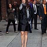Katie Holmes bundled up in a scarf and trench in NYC.