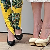 A close-up of Kristen and Kirsten's pumps at the On the Road photocall.
