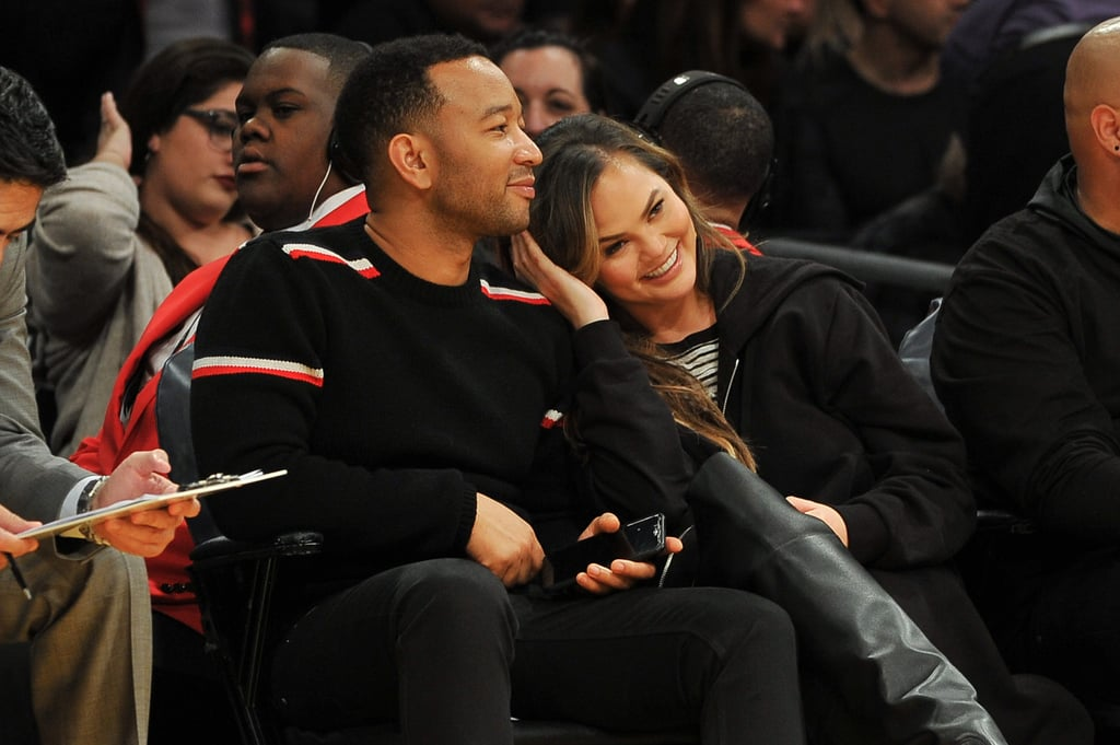 """Chrissy Teigen and John Legend had a sweet, adults-only date night at the Los Angeles Lakers game on Sunday night. Instead of attending the American Music Awards nearby, the couple sat courtside to watch the home team take on the Denver Nuggets at Staples Center. The cameras caught John planting a smooch on Chrissy's head as they took in the game — we're really hoping they ended up on the Kiss Cam at some point! And while we so love getting to see Chrissy and John out on the town together, we also would have loved an appearance from their 1-year-old daughter, Luna, who recently stole the show during Chrissy's """"73 Questions"""" interview with Vogue.       Related:                                                                                                           We Have Chrissy and John to Thank For Keeping Our Faith in Love Alive in 2017"""