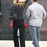 Jennifer Aniston was accompanied by an unknown man.