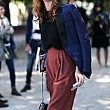 Rust and navy make a perfect pair in this relaxed take on menswear — though it was her mirrored shades that stole the show.