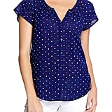 Tiny polka dots give this Old Navy blouse ($27) a sweet feminine feel. Toughen it up for your 9-to-5 by pairing with tailored bottoms.