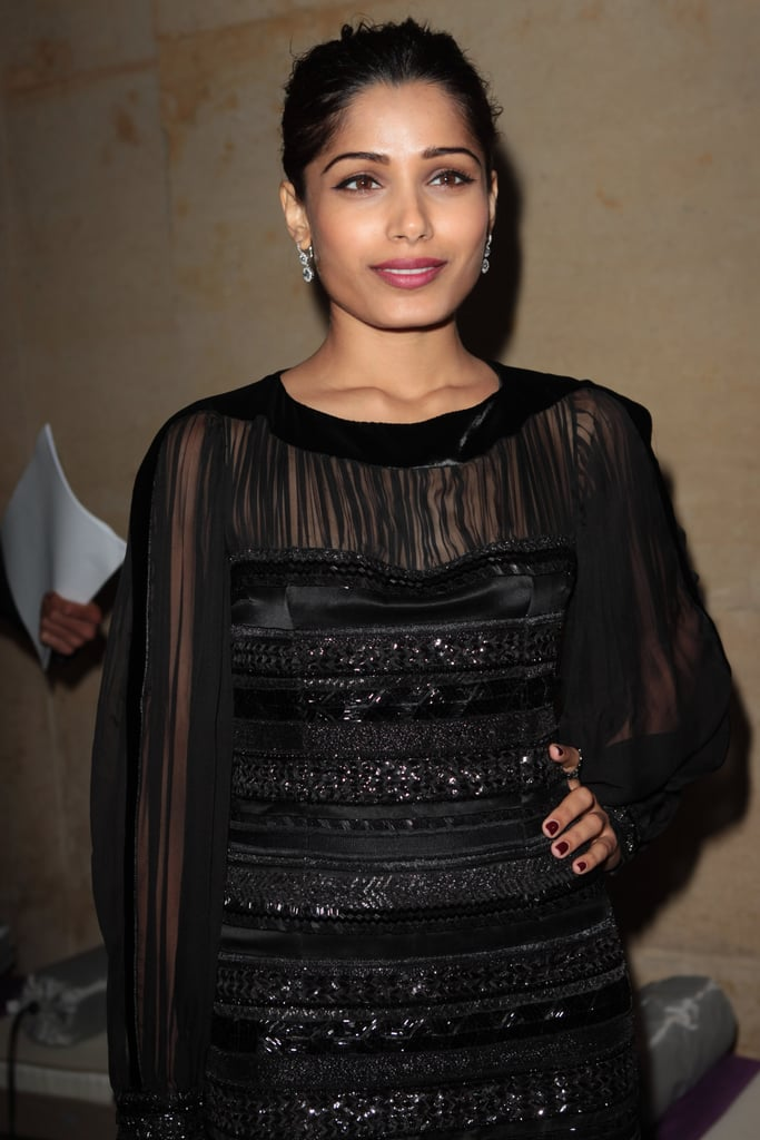 Freida Pinto posed with her hand on her hip at the Salvatore Ferragamo Resort collection show in Paris.