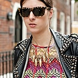 This street styler matched her gold-studded shades to her gold-studded jacket to her gold statement necklace.