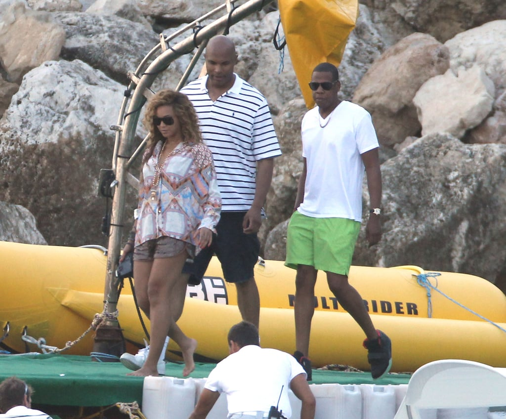 In September 2012, the couple wore their vacation gear while boarding a boat in the South of France. Beyoncé paired a printed blouse with shorts, and Jay sported a white tee with neon green shorts.