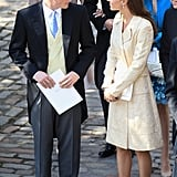 Prince Harry talks with sister-in-law Kate Middleton.