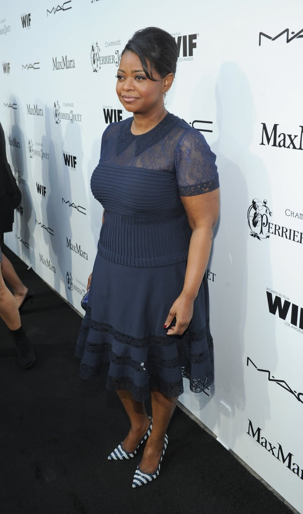 Octavia Spencer coordinated a dainty navy lace Tadashi Shoji dress with nautical striped pumps at the Women in Film Pre-Oscar party in LA.