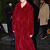 Chrissy was seen leaving a hotel in New York wearing a fuzzy red coat with her Yeezy boots and a Givenchy bag.