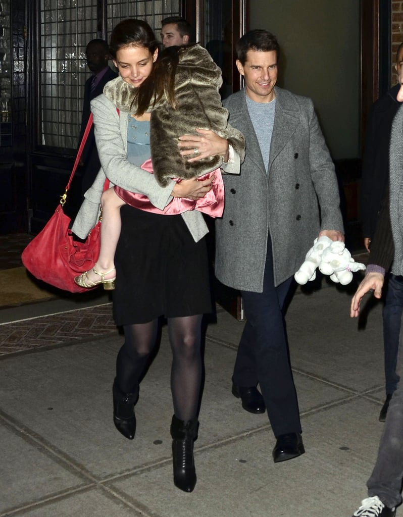Tom held onto Suri's favorite stuffed toy.