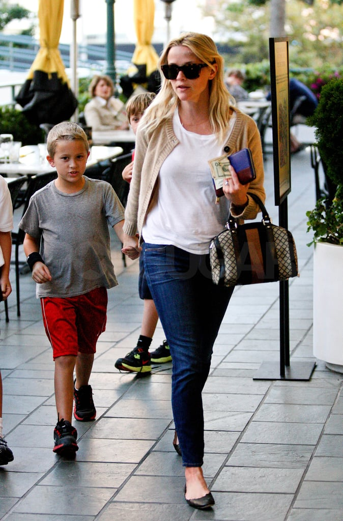 Reese Witherspoon was on carpool duty in LA yesterday. She picked up Deacon Phillippe from school, and the pair were spotted running errands together around town. Reese was dressed in a Fall-inspired camel cardigan, despite the soaring temperatures on the West Coast, and carried Gucci's vintage web top-handle bag. Reese is on a break from working on her new movie Mud in New Orleans to hang at home with Deacon while her costar in the film, Matthew McConaughey, juggles another project as well. Matthew McConaughey shot shirtless scenes for Magic Mike in Tampa, FL yesterday. Mud is Reese and Matthew's first big-screen project together, though the pair often hang out at family barbecues and philanthropic functions with her husband, and Matthew's agent, Jim Toth.
