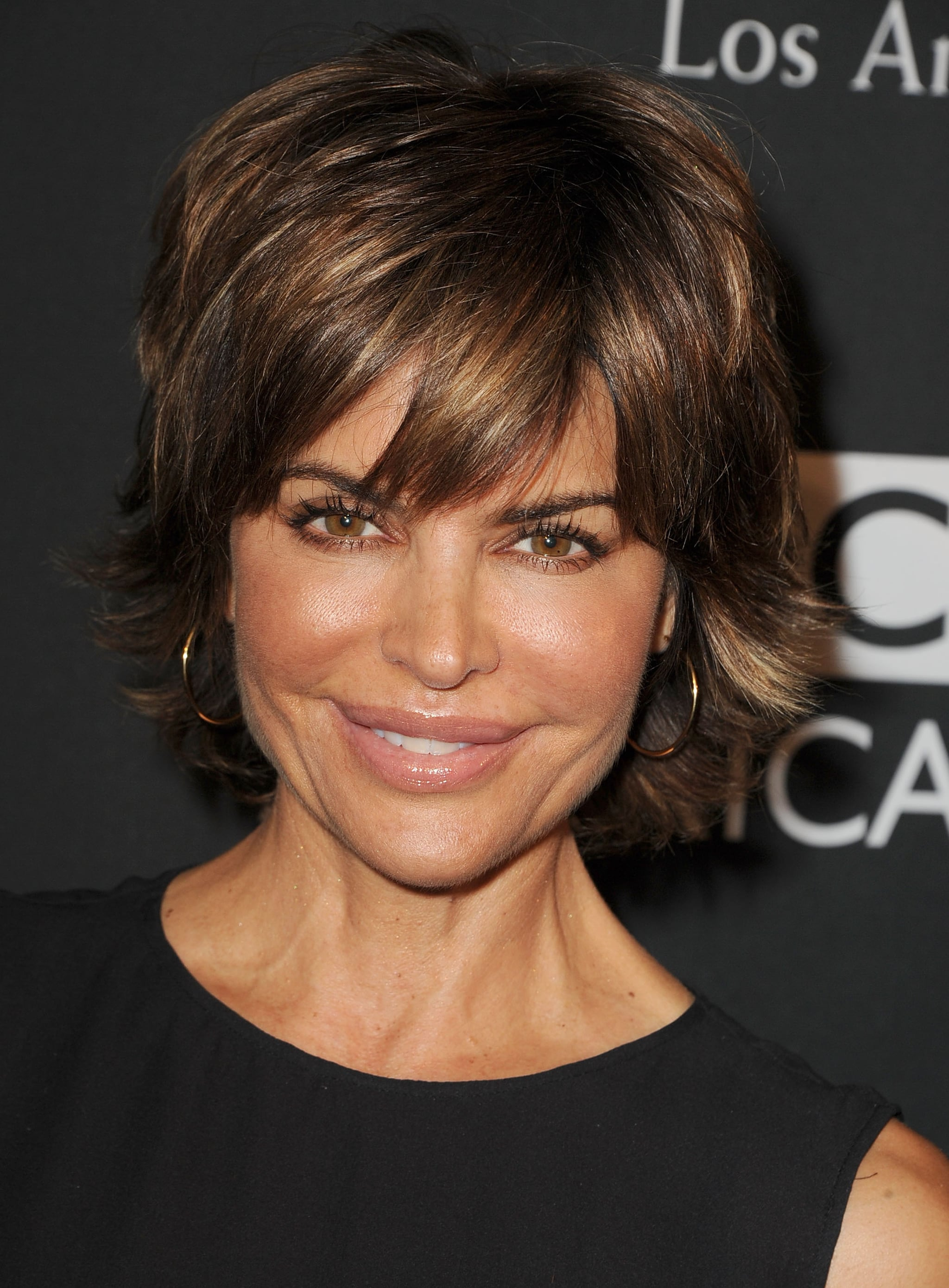 Lisa Rinna stuck to her signature look for the BAFTA LA TV Tea, but perhaps she'll liven up her look for the red carpet at the Emmys tonight.