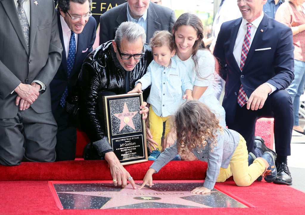 Jeff Goldblum first stole our hearts in 1974's Death Wish, and now he's finally getting the recognition he deserves. On Thursday, the 65-year-old actor was honoured with his very own star on the Hollywood Walk of Fame. Jeff, of course, brought along his beautiful wife, Emilie Livingston, and their two adorable children, 2-year-old Charlie Ocean and 1-year-old River Joe, as well as attorney Norman L. Eisen and actor Ed Begley Jr. Charlie and River pretty much stole the show as they crawled on the floor and proudly pointed at their dad's star. Jeff's star is the 2,638th, and he now joins the ranks of fellow actors Chris Pratt, Dwayne Johnson, Zoe Saldana, and several others. Jeff's coveted honour comes eight days before the release of his new movie, Jurassic World: Fallen Kingdom, which also stars Chris and Bryce Dallas Howard. Jeff is also currently working on another film titled The Mountain with Tye Sheridan and Hannah Gross. Congrats Jeff!      Related:                                                                                                           For When Times Are Tough, Here Are 22 Pictures of Jeff Goldblum in a Leather Jacket