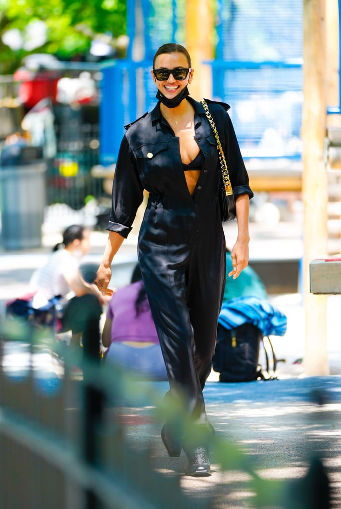 Irina Shayk Wearing a Black Jumpsuit and Lace-Up Boots in NYC