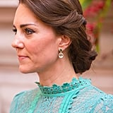 For lunch with the Indian prime minister, Kate wore a new pair of Kiki McDonough earrings made of green tourmalines, green amethysts, and diamonds, which cost $4,985. They were made specially for Kate and are said to have been a gift to celebrate the birth of Princess Charlotte. The most likely gift-giver would of course be Prince William.